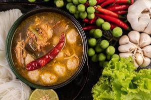 Rice noodle dish with chilies, melon, lentils and lemon