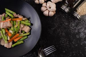 Stir-fried long beans and carrots with pork belly