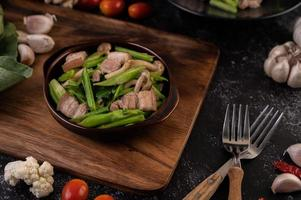 Stir-fried kale and pork belly photo