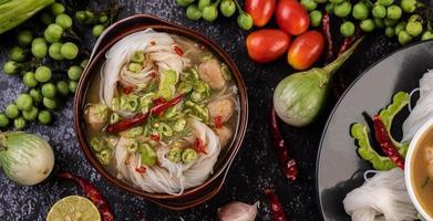 Rice noodles with chilies, melon, lentils and lemon photo