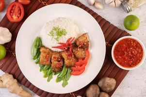 Pork belly on streamed rice with vegetables photo