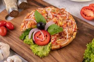 Homemade pizza on a cutting board photo