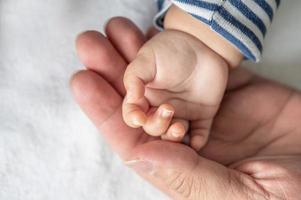 A newborn baby hand