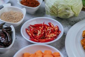 Diced carrots, dried chilies, roasted rice, chili, and cabbage photo