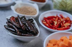 Diced carrots, dried chilies, roasted rice, and chili paste photo
