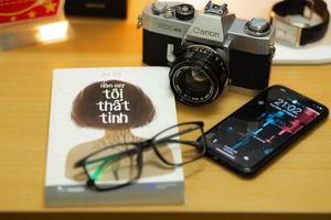 Camera, book and phone