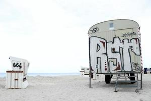 Painted van parked on the beach