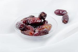 Dates in a bowl on a white background