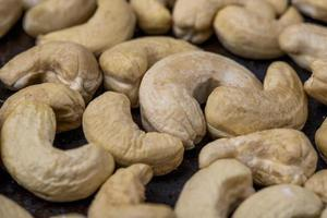 Close-up of cashews on a black background
