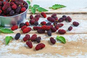 Mulberries on a wooden table photo