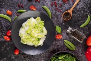 Stir fried cabbage on a black plate