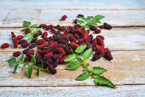 Mulberries on a rustic table photo
