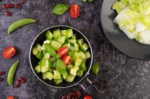 Cucumbers with tomatoes and beans in a frying pan