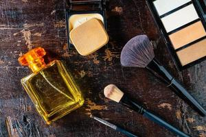 Top view of makeup and perfume