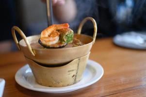 Cha-om sour soup with shrimp photo