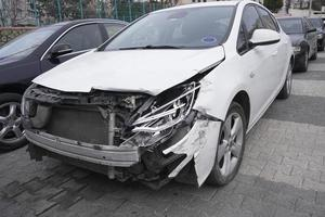Crashed white car at street