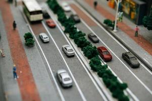 Close-up of miniature traffic on the road