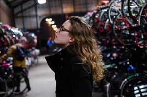 Girl in a bike store photo