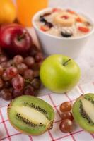 Kiwi, grapes, apples, and oranges
