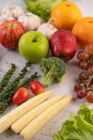 Apples, oranges, broccoli, baby corn, grapes and tomatoes