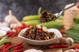 Top view of spicy minced meat in a spoon