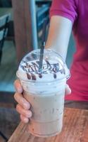 Frozen coffee in a hand