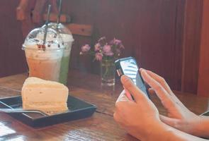 Person taking a photo of cake