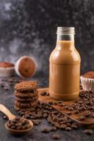 Cookies with coffee beans and milk