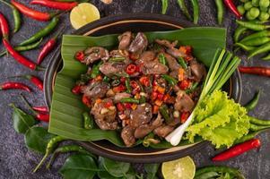 Stir-fried basil chicken liver on banana leaves