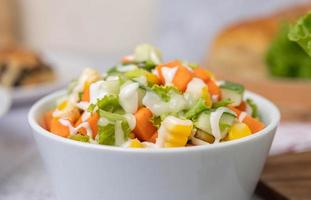 Cucumber, corn, carrot and lettuce salad