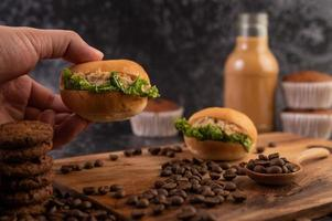 Burgers with coffee beans on a brown wooden slab