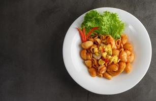 Stir fried macaroni with tomatoes