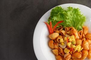 Stir fried macaroni with tomatoes