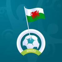 Wales vector flag pinned to a soccer ball
