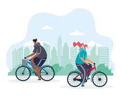 young couple riding bicycle wearing medical masks