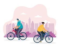 young men riding bicycle wearing medical mask