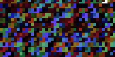 Fondo de vector multicolor claro en estilo poligonal.