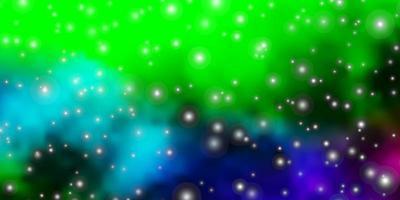 Fondo de vector multicolor oscuro con estrellas de colores.