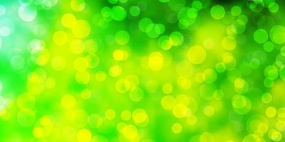 Light Green, Yellow vector backdrop with dots.