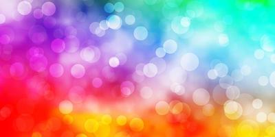 Telón de fondo de vector multicolor claro con círculos.