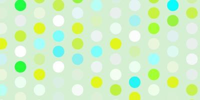 Light blue, green vector background with spots.