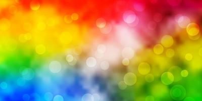 Light Multicolor vector background with circles.