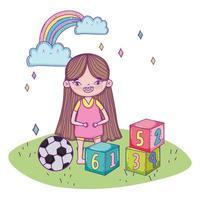 feliz día del niño, linda chica con bloques y balón de fútbol en el césped