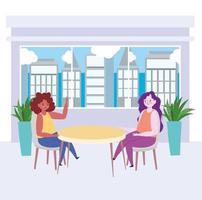 restaurant social distancing, two women talking in new normal, covid 19 coronavirus