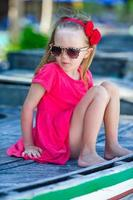 Portrait of beautiful little girl outdoor at tropical resort