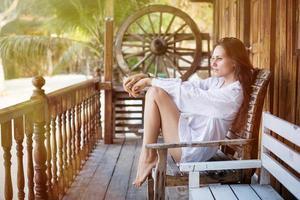 Beautiful young woman near home