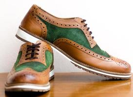 Close-up of brown and green shoes