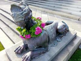 New York City, NY, 2020 - Statue with flowers on it photo
