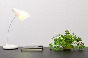 Book and lamp on the table