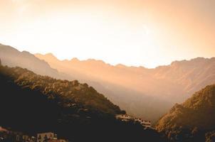 Sunrise above mountains photo
